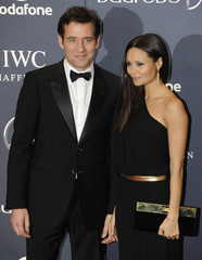Actors Clive Owen and Thandie Newton pose for photographs as they arrive for the Laureus World Sports Awards 2012 in central London