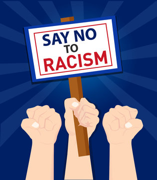 Human hand protesters holding the placard board with say no to racism tag line text at the Trump Protests in USA America