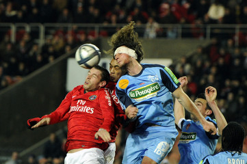 Paris St Germain's Armand fights for the ball with Brest's Baysse during their French Ligue 1 soccer match in Paris
