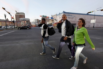 Cuban migrants walk on a street after travelling en route from Panama to Mexico and the United States, as part of a pilot programme agreed by Central American countries to allow the migrants to continue towards the U.S., in El Paso, Texas