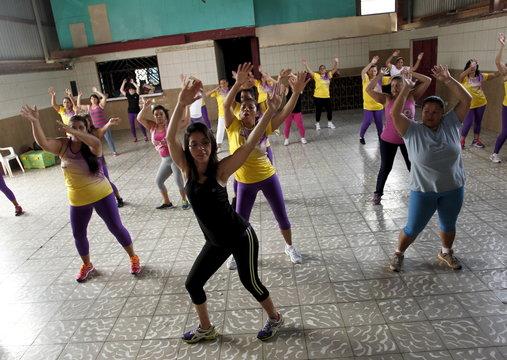 Andrea Abarca, leads an aerobics class in Los Guidos de Desamparados