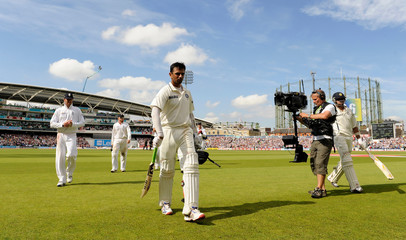 India's Dravid leaves the field 146 not out after India's were all out for 300 runs during the fourth cricket test match against England at the Oval cricket ground in London