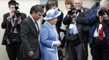 Britain's Queen Elizabeth is escorted by John Osborne during her visit to the Irish National Stud in Kildare