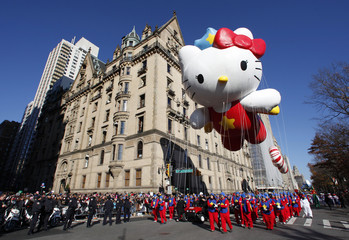 The Super Cute Hello Kitty balloon floats down Central Park West during the 85th Macy's Thanksgiving day parade in New York