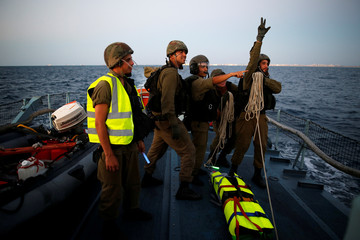 Israeli soldiers from the navy take part in a combined drill with a helicopter squadron, practicing the evacuation of a wounded person to land from a vessel in the Mediterranean Sea, off the coast of Ashdod, southern Israel