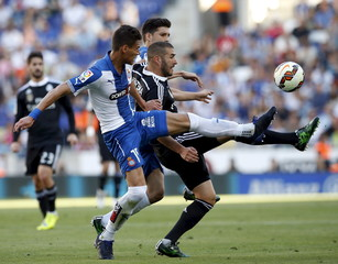 Real Madrid's Benzema fights for the ball with Espanyol's Hector Moreno during their Spanish first division soccer match near Barcelona