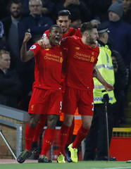 Liverpool's Georginio Wijnaldum celebrates scoring their first goal with team mates
