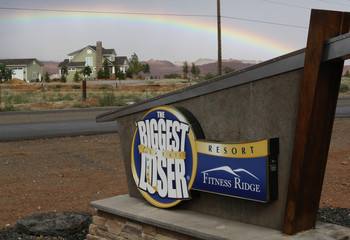 A rare rainbow is seen over the sign at the Biggest Loser Resort in Ivins