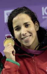 Morocco's El Bekri shows her gold medal after winning the women's 50m breaststroke final at the Arab Games in Doha