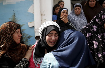 Relatives of 13-year-old Palestinian boy Ahmed Sharaka, who was killed by Israeli troops during Sunday's clashes, mourn during his funeral in Jalazoun refugee camp near Ramallah