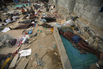 Ethiopian migrants sleep out in the open near a transit centre where they wait to be repatriated, in the western Yemeni town of Haradh, on the border with Saudi Arabia