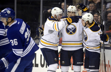 Buffalo Sabres Tyler Ennis celebrates his goal with teammates Marcus Foligno and Drew Stafford at their NHL hockey game in Toronto