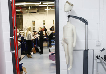 A mannequin is placed by a door at the Fashion Enter factory in London