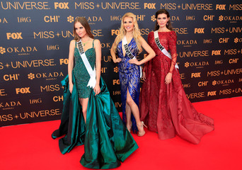 Miss Universe candidates pose for a picture during a red carpet inside a SMX convention in metro Manila