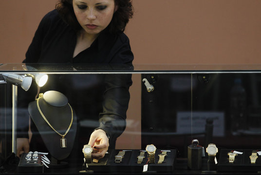 Gold watches and jewelry confiscated from Peru's former head of Intelligence Vladimiro Montesinos are displayed to the media before auction, in Lima