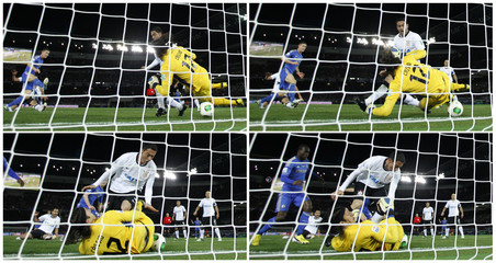 Combo pic of goalkeeper Cassio of Brazil's Corinthians and teammate Chicao scrambling to stop a ball kicked by Cahill of Britain's Chelsea from crossing the goal line during their Club World Cup final soccer match in Yokohama