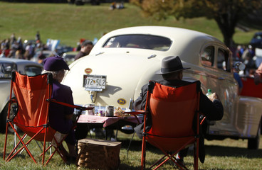 A couple enjoys afternoon tea and a picnic lunch near their 1941 Pontiac at the annual Rockville Maryland Antique and Classic Car Show