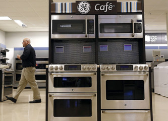 Sears employee walks past a display of General Electric appliances in Schaumburg