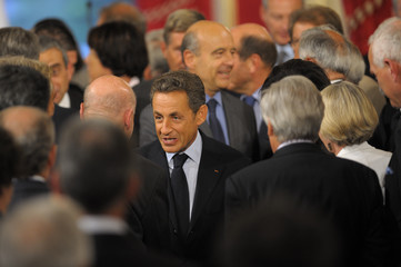 France's President Sarkozy leaves the Annual French Ambassadors Conference at the Elysee Palace, in Paris
