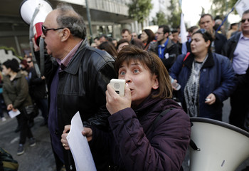 Visually impaired Greek protesters march to the Finance Ministry during a rally against austerity cuts in central Athens