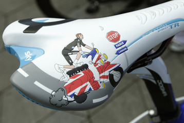 A drawing is pictured on the bike saddle belonging to Britain's Bradley Wiggins before the start of the men's road race elite event at the UCI World cycling championships in Copenhagen