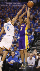 Los Angeles Lakers guard Fisher shoots over Oklahoma City Thunder guard Westbrook during their NBA Western Conference playoff series in Oklahoma City.