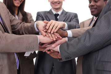 Close up top view of business people putting their hands togethe