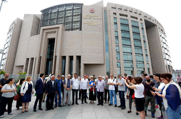 Mater, Balikci, Turker and Eryilmaz, who were guest editors at pro-Kurdish daily Ozgur Gundem, are pictured with their fellow journalists before they appear at a court for testimony, outside the Justice Palace in Istanbul
