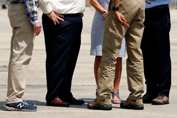 U.S. President Barack Obama and elected officials who greeted him upon arriving aboard Air Force One were all seen wearing comfortable shoes to tour flood-affected areas at Baton Rouge Metropolitan Airport in Baton Rouge