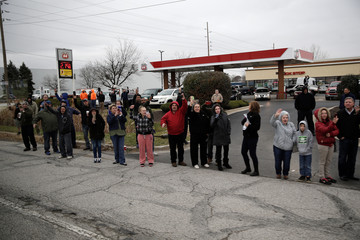 People line the street as the motorcade carrying U.S. President-elect Donald Trump passes on his way to tour a Carrier factory in Indianapolis