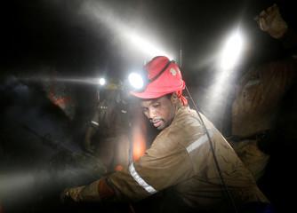 Miners work deep underground at Sibanye Gold's Masimthembe shaft in Westonaria