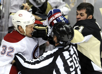 Pittsburgh Penguins' Evgeni Malkin (71) Montreal Canadiens' Travis Moen in the third period of their NHL hockey game in Pittsburgh