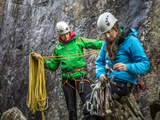 Rock climbers organizing equipment