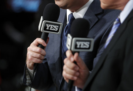 YES Network logos are seen on microphones of announcers Eagle and Fratello before Los Angeles Lakers play Brooklyn Nets in NBA basketball game in Los Angeles