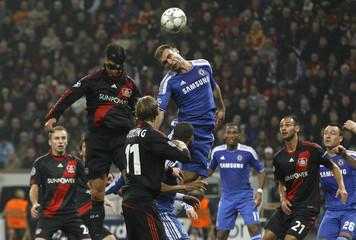 Bayer Leverkusen's Ballack and Chelsea's Ivanovic head a ball during the Champions League Group E soccer match in Leverkusen