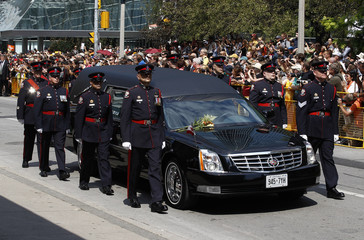 The hearse carrying NDP Opposition Leader Jack Layton arrives at his state funeral in Toronto