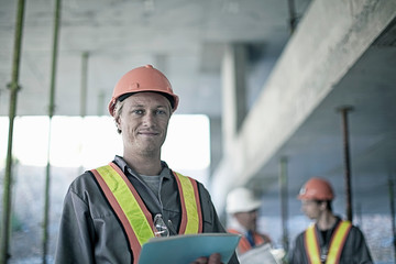 Construction worker smiling on site