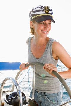 Smiling woman steering boat