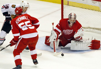 Red Wings goalie Jimmy Howard makes a save on Blackhawks Jonathan Toews in the first period of Game 3 of their NHL Western Conference semi-finals hockey game in Detroit