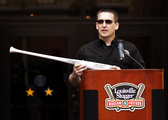 Hillerich & Bradsby's Bob Hillerrich addresses the crowd about their new bats and logo at a news conference to launch the new logo after 33 years on all their baseball bats for the upcoming season at the Louisville Slugger plant
