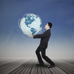 Businessman lifting the earth planet
