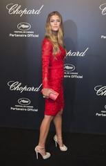 Model Nina Agdal poses during a photocall ahead of the Chopard Gold Party during the 68th Cannes Film Festival in Cannes