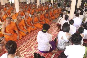 Buddhist monks sit inside a pagoda on the first day of the Pchum Ben festival in Phnom Penh