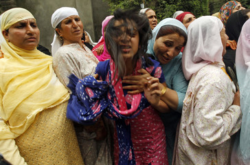 An unidentified relative of Abdul Rehman Ganie cries after the body of Rehman was brought home for funeral in Srinagar