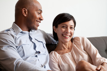 Couple relaxing on sofa, portrait