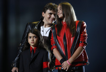 "Michael Jackson's children Blanket, Prince and Paris stand on stage during the ""Michael Forever"" tribute concert, which honours late pop icon Michael Jackson, at the Millennium Stadium in Cardiff"