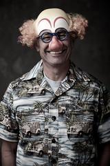Portrait of a senior man wearing clown mask