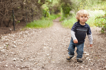 Boy walking on dirt track