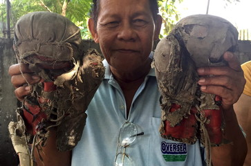 Filipino boxing icon Manny Pacquiao's old worn out gloves is shown in General Santos