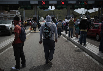 Students from Ayotzinapa Teacher Training College take part during a blockade along a road leading to Acapulco, demanding the government find 43 of the school's students, missing since last month's deadly clashes, near in Chilpancingo